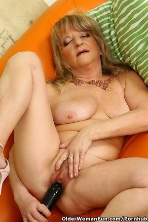 60 year old granny Lotta fucks a big black dildo