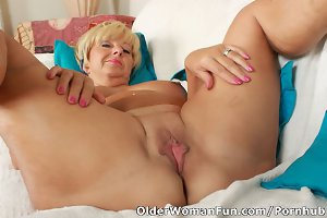 Granny Samantha strips off and spreads her old pussy